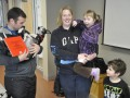 Rob McLeod and his canine teammate Davy Whippet pose for a photo with fans at a book reading event. From left are McLeod holding the dog, Courtney Hallett and Delilah Hallett, and Sawyer Patterson. Photo: Doug Dickinson/Bugle-Observer